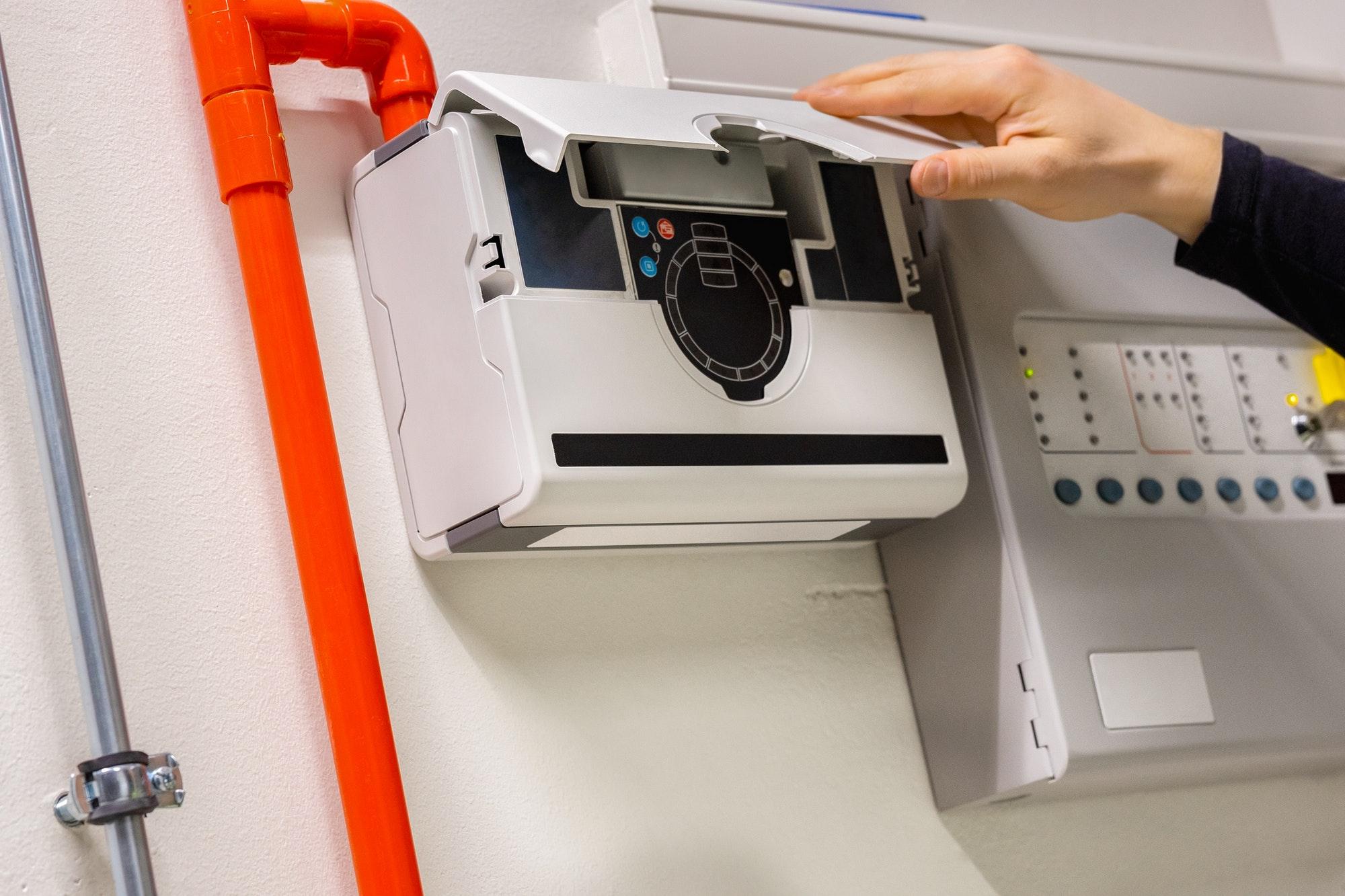 Engineer Checking Smoke Sensor Pannel In Datacenter