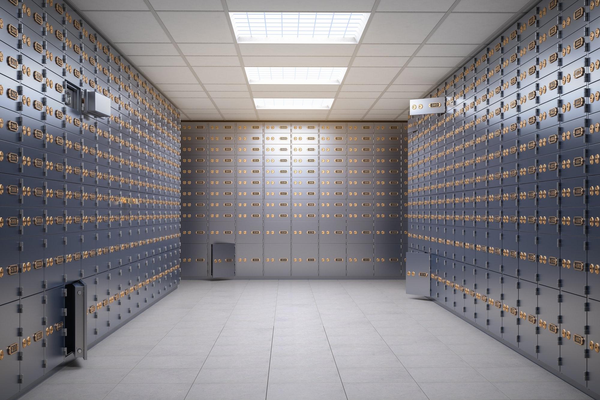Safe deposit boxes room inside of a bank vault.